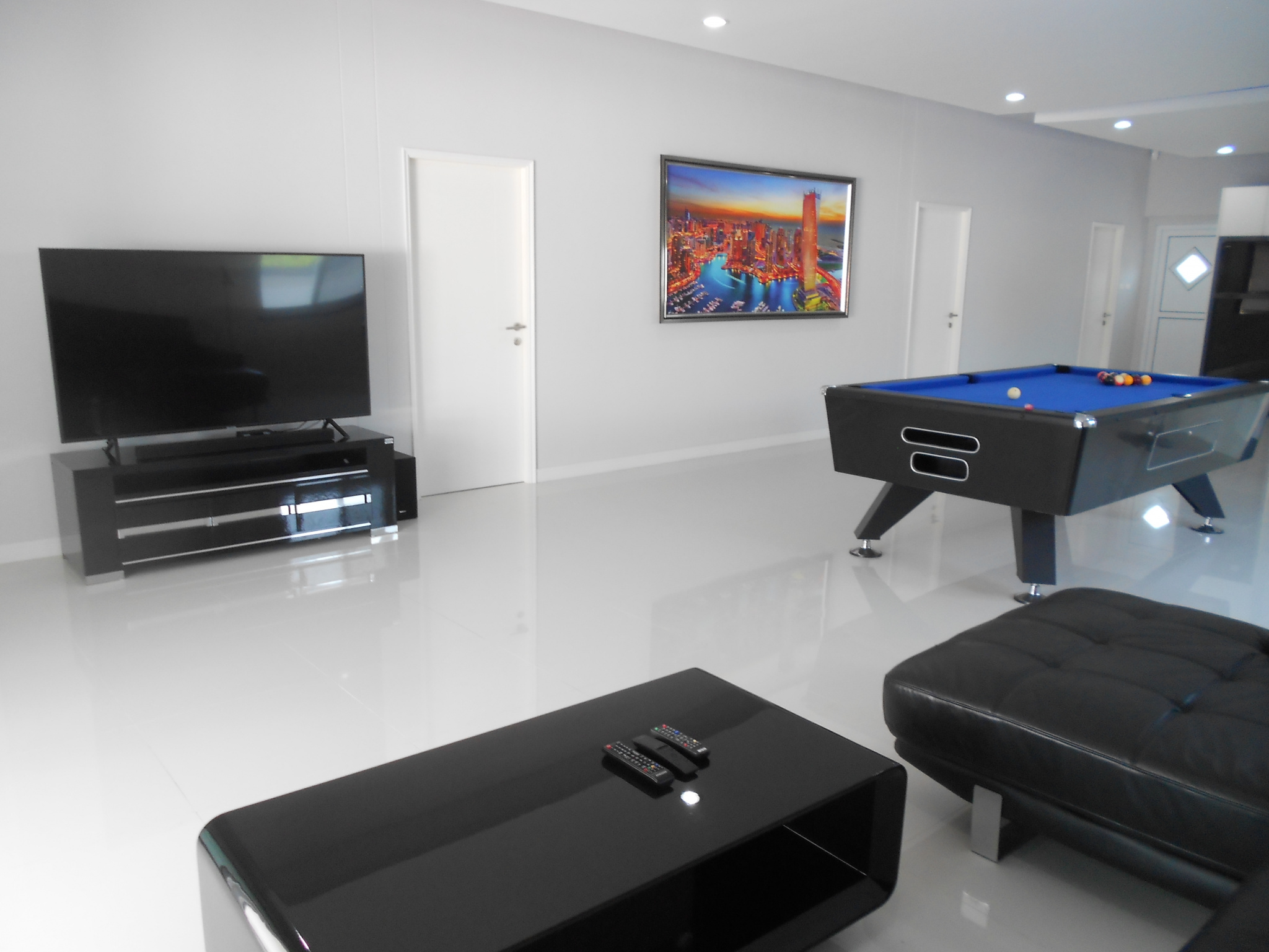 Large living room with furniture and pool table